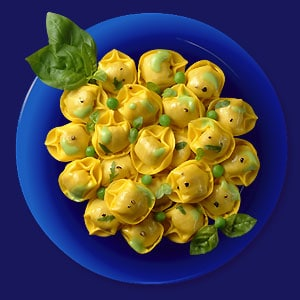 Tortelloni con Prosciutto Crudo aux légumes